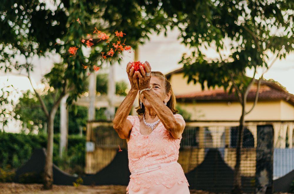senior blowing flowers