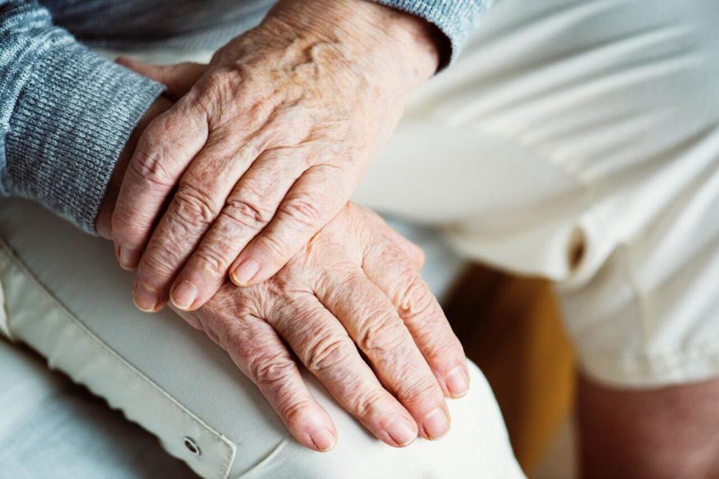 senior arthritic hands